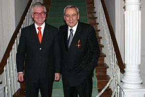 Dr. M. Cengiz Sezen, Chairman of the Board, receiving the Federal Cross of Merit of the Federal Republic of Germany